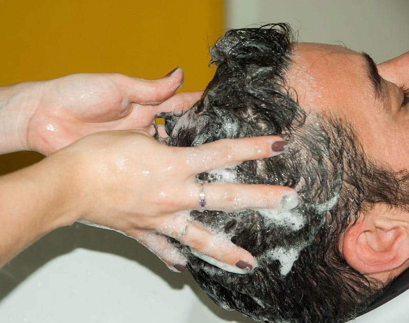 washing hair with a shampoor
